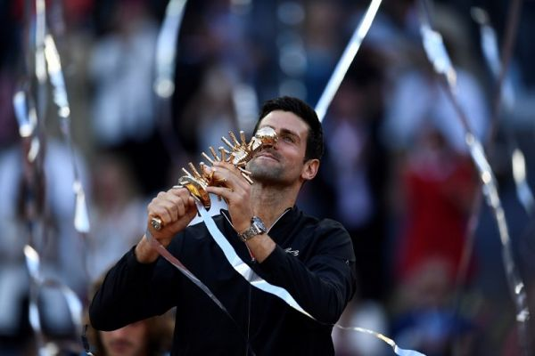 Serbia's Novak Djokovic holds with his trophy after winning the ATP Madrid Open final tennis match at the Caja Magica in Madrid on May 12, 2019. PHOTO/AFP