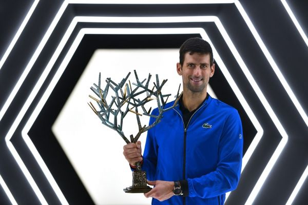 Serbia's Novak Djokovic poses with his trophy after winning against by Canada's Denis Shapovalov during their men's singles final tennis match at the ATP World Tour Masters 1000 - Rolex Paris Masters - indoor tennis tournament at The AccorHotels Arena in Paris on November 3, 2019. PHOTO | AFP