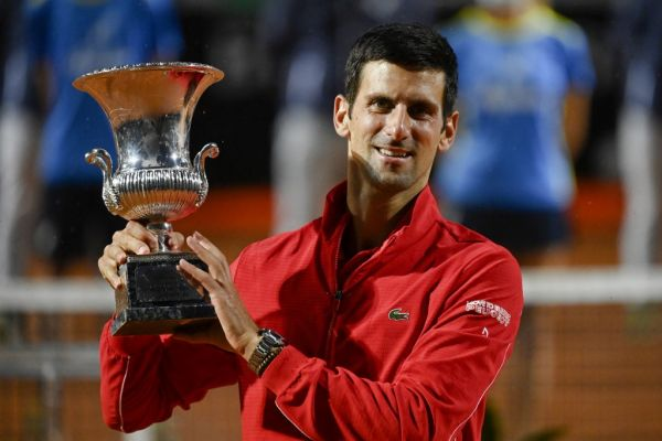 Serbia's Novak Djokovic poses with his trophy after winning the final match of the Men's Italian Open against Argentina's Diego Schwartzman at Foro Italico on September 21, 2020 in Rome, Italy. PHOTO | AFP