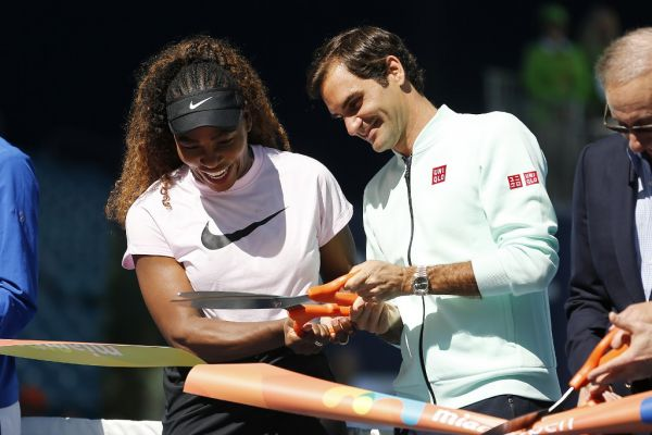 Serena Williams of the United States and Roger Federer of Switzerland cut the ribbon during the Ribbon Cutting ceremony on Day 3 of the Miami Open Presented by Itau on March 20, 2019 in Miami Gardens, Florida. PHOTO | AFP