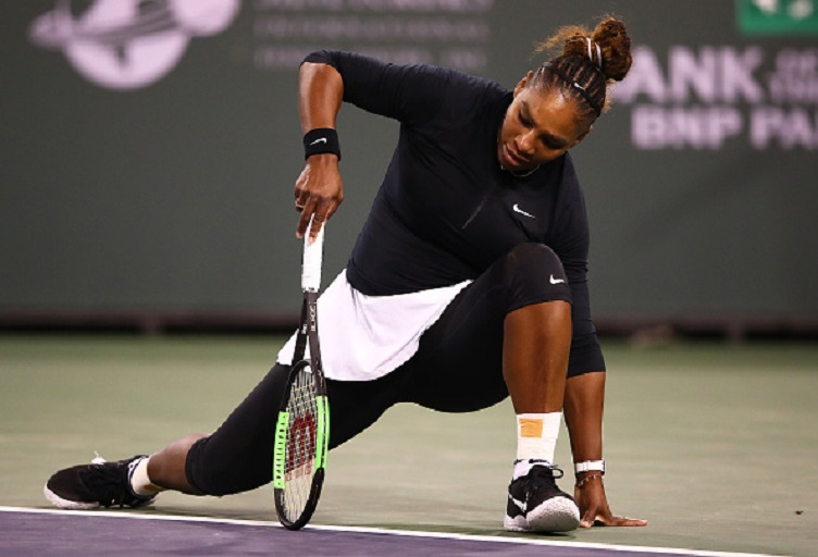 Serena Williams of the United States slips after playing a shot against Victoria Azarenka of Belarus during their women's singles second round match on day five of the BNP Paribas Open at the Indian Wells Tennis Garden on March 08, 2019 in Indian Wells, California. PHOTO/GettyImages
