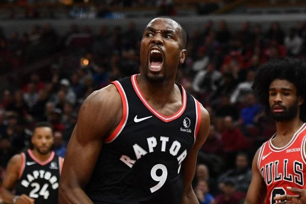 Serge Ibaka #9 of the Toronto Raptors celebrates a dunk against the Chicago Bulls during the first quarter at United Center on October 26, 2019 in Chicago, Illinois. PHOTO | AFP