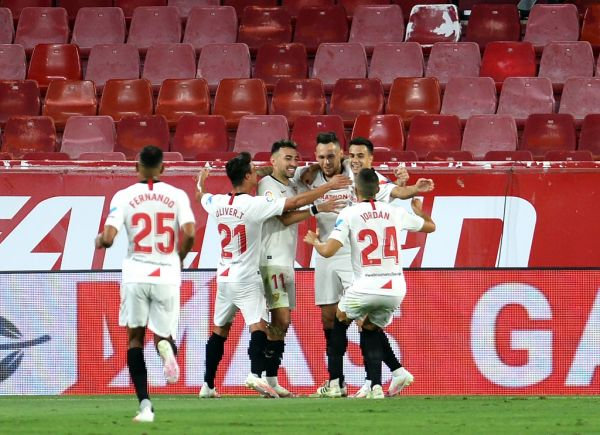 Sevilla's Argentinian midfielder Lucas Ocampos (3R) celebrates after scoring a goal during the Spanish league football match between Sevilla FC and RCD Mallorca at the Ramon Sanchez Pizjuan stadium in Seville on July 12, 2020. PHOTO   AFP