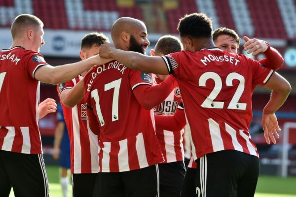 Sheffield United's English-born Irish striker David McGoldrick (C) celebrates with teammates after scoring his second goal during the English Premier League football match between Sheffield United and Chelsea at Bramall Lane in Sheffield, northern England on July 11, 2020. PHOTO | AFP