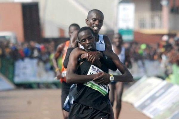 Simon Cheprot carries injured compatriot Kenneth Kipkemoi across the line in the 2019 Okpekpe International 10Km race on Saturday, May 25, 2019. PHOTO/Courtesy