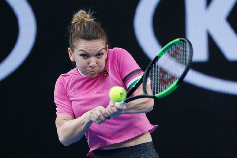 Simona Halep of Romania plays a backhand in her first round match against Kaia Kanepi of Estonia during day two of the 2019 Australian Open at Melbourne Park on January 15, 2019 in Melbourne, Australia. PHOTO/GettyImages