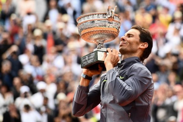 Spain's Rafael Nadal poses with the Mousquetaires Cup (The Musketeers) at the end of the men's singles final match against Austria's Dominic Thiem on day fifteen of The Roland Garros 2019 French Open tennis tournament in Paris on June 9, 2019. PHOTO/AFP