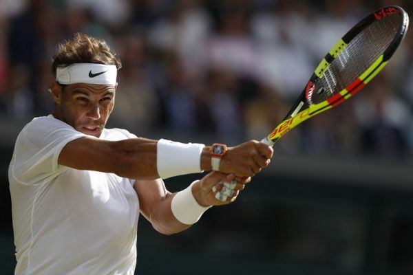 Spain's Rafael Nadal returns against Australia's Nick Kyrgios during their men's singles second round match on the fourth day of the 2019 Wimbledon Championships at The All England Lawn Tennis Club in Wimbledon, southwest London, on July 4, 2019. PHOTO   AFP
