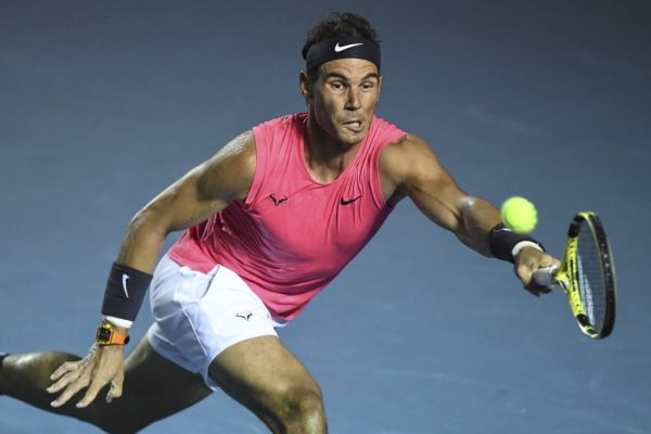 Spain's Rafael Nadal returns the ball to Serbia's Miomir Kecmanovic (out of frame) during their Mexico ATP Open 500 men's singles tennis match in Acapulco, Guerrero State, Mexico, on February 26, 2020. PHOTO | AFP