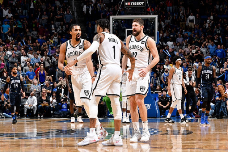 Spencer Dinwiddie #8, D'Angelo Russell #1, and Joe Harris #12 of the Brooklyn Nets react to a plau during the game against the Orlando Magic on January 18, 2019 at Amway Center in Orlando, Florida. PHOTO/GETTY IMAGES