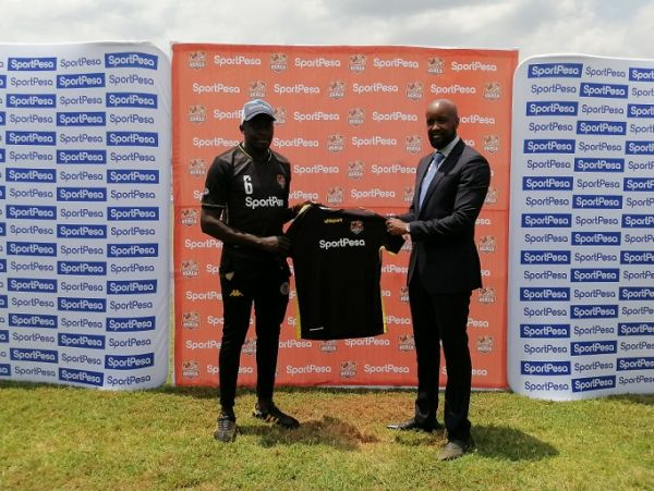 SportPesa Chief Executive Officer, Captain Ronald Karauri (left) poses with a Murang'a Seal jersey alongside Team Manager John Wanjie at the St. Sebastien Park in Murang'a on Friday, October 1, 2021. PHOTO |Courtesy