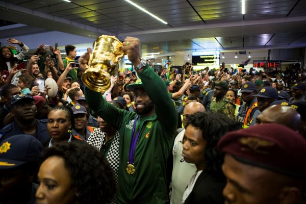 Springbok captain, Siya Kolisi, holding the World Rugby Cup after his arrival at O.R. Tambo International Airport in Johannesburg, South Africa on November 5, 2019 South Africa's World Cup winning rugby squad arrived home on Tuesday to a heroes' welcome and will be embarking on a nation wide Champions Tour. PHOTO | AFP