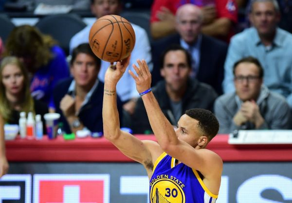 Steph Curry of the Golden State Warriors shoots for three against the Los Angeles Clippers during their NBA game in Los Angeles, California on November 19, 2015 where the Warriors defeated the Clippers 124-117. PHOTO | AFP