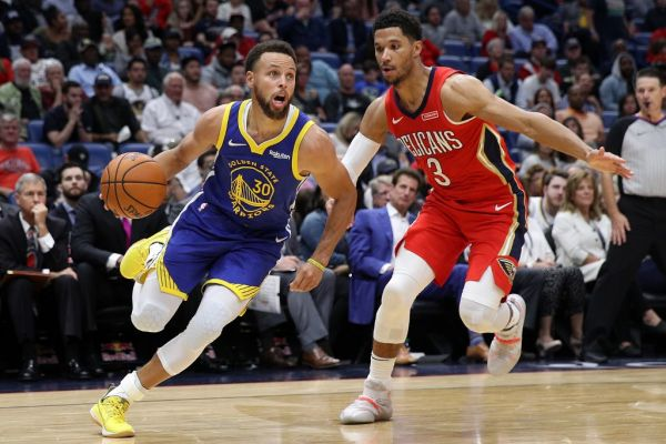 Stephen Curry #30 of the Golden State Warriors drives the ball around Josh Hart #3 of the New Orleans Pelicans at Smoothie King Center on October 28, 2019 in New Orleans, Louisiana. PHOTO   AFP
