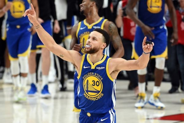 Stephen Curry of the Golden State Warriors celebrates defeating the Portland Trail Blazers 119-117 during overtime in game four of the NBA Western Conference Finals to advance to the 2019 NBA Finals at Moda Center on May 20, 2019 in Portland, Oregon. PHOTO/AFP