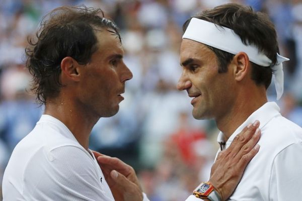 Switzerland's Roger Federer (R) shakes hands and embraces Spain's Rafael Nadal (L) after Federer won their men's singles semi-final match on day 11 of the 2019 Wimbledon Championships at The All England Lawn Tennis Club in Wimbledon, southwest London, on July 12, 2019. PHOTO/AFP