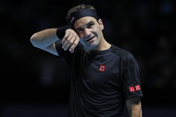 Switzerland's Roger Federer gestures against Austria's Dominic Thiem during their men's singles round-robin match on day one of the ATP World Tour Finals tennis tournament at the O2 Arena in London on November 10, 2019.  PHOTO | AFP