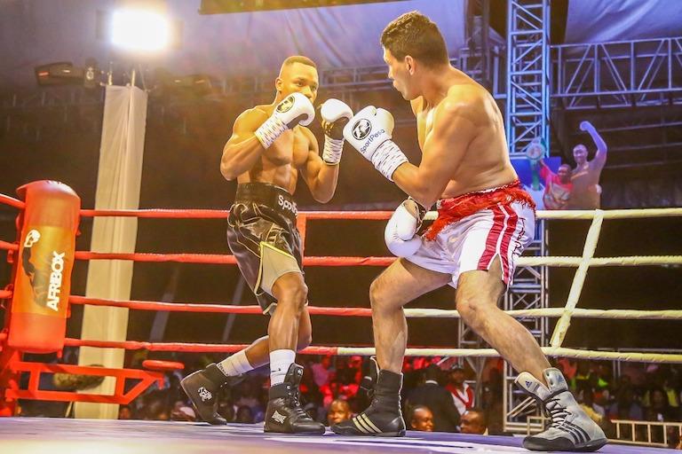Tanzania boxer, Hassan 'Champez' Mwakinyo (left) fights Argentine Sergio Eduardo Gonzalez during the main undercard of Nairobi Fight Night 2 on Saturday, March 23. PHOTO/Brian Kinyanjui/SPN