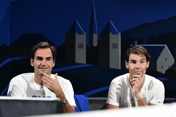 Team Europe's Roger Federer (L) and teammate Rafael Nadal watch a match as part of the 2019 Laver Cup tennis tournament in Geneva, on September 20, 2019. PHOTO | AFP