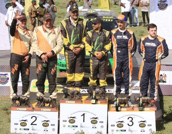The 2019 Safari Rally top three finishers fill the podium following the conclusion of the WRC Candidate Event in Naivasha on Sunday, July 7, 2019. The winning car, a Mitsubishi Lancer Evo X is behind. PHOTO/SPN