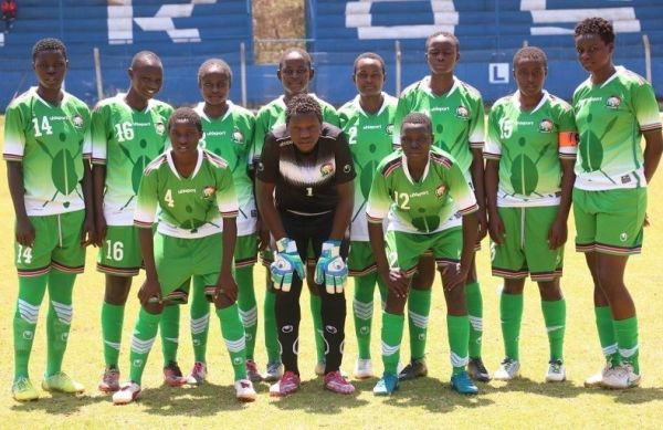 The Kenya U20 women team poses for a photo before a past buildup friendly match against the National U13 boys team at the Machakos Stadium. PHOTO/ FKF