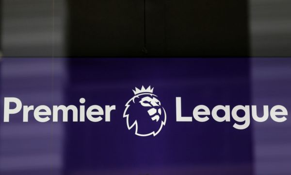 The logo is pictured through a glass window at the headquarters of the English Premier League in London on March 13, 2020. The English Premier League suspended all fixtures until April 4 on Friday after Arsenal manager Mikel Arteta and Chelsea winger Callum Hudson-Odoi tested positive for coronavirus. PHOTO | AFP