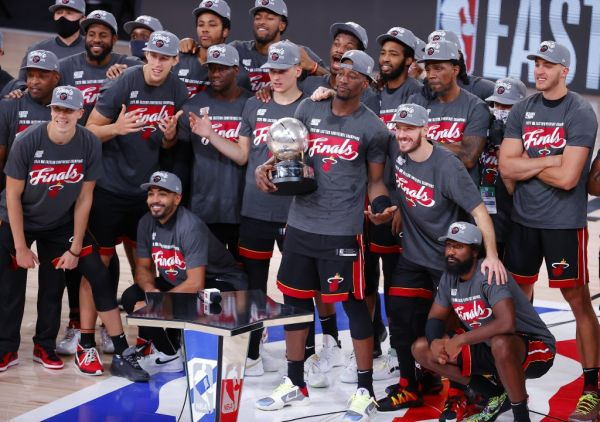The Miami Heat celebrate with the trophy after they are Eastern Finals Champions against the Boston Celtics in Game Six of the Eastern Conference Finals during the 2020 NBA Playoffs at AdventHealth Arena at the ESPN Wide World Of Sports Complex on September 27, 2020 in Lake Buena Vista, Florida. PHOTO | AFP
