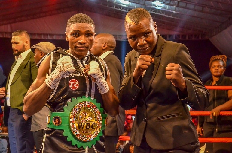 The present and past queens of Kenyan boxing, Fatuma 'Iron Fist' Zarika and Conjestina 'Hands of Stone' Achieng' (right) pose after the former retained her World Boxing Council Super Bantamweight title at Nairobi Fight Night 2 on Saturday, March 23, 2019. PHOTO/SPN
