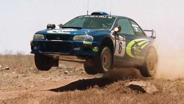 The Subaru Impreza WRC of Finns Juha Kankkunen and Juha Repo flies through the air 26 February during the safari Rally before his car developed electrical problems and was forced out. Spaniard Carlos Sainz won the stage. PHOTO | AFP