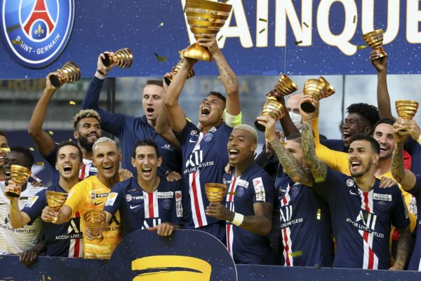Thiago Silva of PSG holding the League Cup, Pablo Sarabia, goalkeeper Keylor Navas, Angel Di Maria, Presnel Kimpembe, Leandro Paredes and teammates celebrate the victory during the trophy ceremony following the French League Cup (Coupe de la Ligue) final match between Paris Saint-Germain (PSG) and Olympique Lyonnais (OL, Lyon) on July 31, 2020 at the Stade de France, in Saint-Denis, near Paris, France. PHOTO | AFP