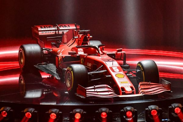 This photo taken and handout by the Ferrari Press Office on February 11, 2020 shows the new Ferrari Formula One SF1000 during its unveiling ceremony at Teatro Romolo-Valli in Reggio Emilia. PHOTO | AFP