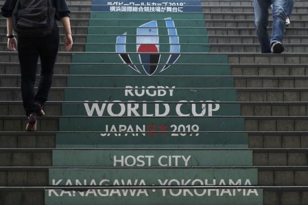 This picture taken on September 6, 2019 shows commuters walking down steps with the Rugby World Cup logo at an entrance of the Shin-Yokohama railway station in Yokohama, Kanagawa prefecture, a host city of the upcoming 2019 Rugby World Cup in Japan. PHOTO | AFP