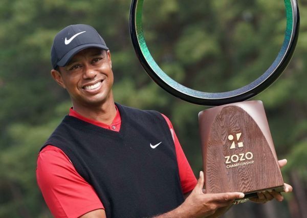 Tiger Woods, an American professional golf player, celebrates during an awarding ceremony of ZOZO CHAMPIONSHIP at Accordia Golf Narashino Country Club in Inzai City, Chiba Prefecture, Japan on October 28, 2019. 43-year-old Woods claimed his 82th PGA tournament to tie all-time victory records. PHOTO | AFP