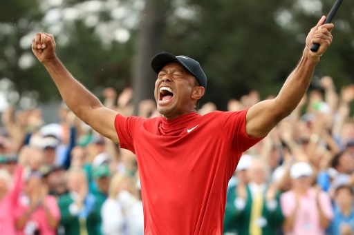 Tiger Woods of the United States celebrates after sinking his putt on the 18th green to win during the final round of the Masters at Augusta National Golf Club on April 14, 2019 in Augusta, Georgia. Andrew. PHOTO/AFP