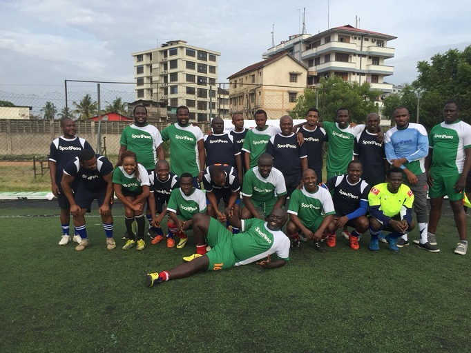 Tnazanian and Kenyan media teams pose for a photo before playing in a pre-SportPesa Cup friendly match at the Karume Grounds in Dar es Saalam, Tanzania. PHOTO/Courtesy