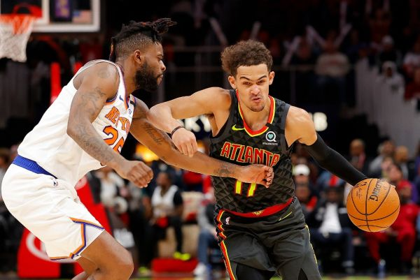 Trae Young #11 of the Atlanta Hawks drives against Reggie Bullock #25 of the New York Knicks in double overtime at State Farm Arena on February 09, 2020 in Atlanta, Georgia. PHOTO | AFP
