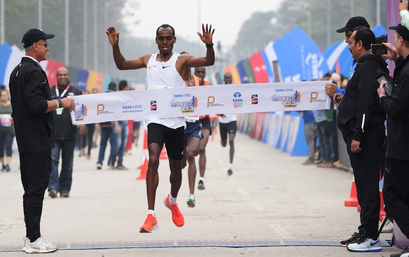 TSK25K 2018 men's winner Birhanu Legese pictured while crossing the line on Sunday, December 16. PHOTO/Courtesy/Procam International