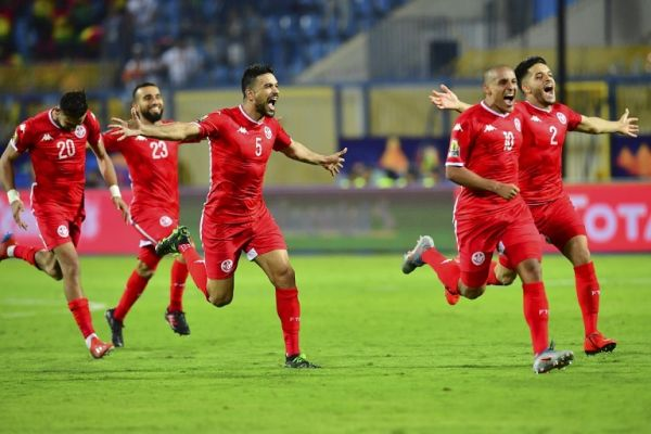 Tunisia's players celebrate their win during the 2019 Africa Cup of Nations (CAN) Round of 16 football match between Ghana and Tunisia at the Ismailia Stadium in the Egyptian city on July 8, 2019. PHOTO | AFP