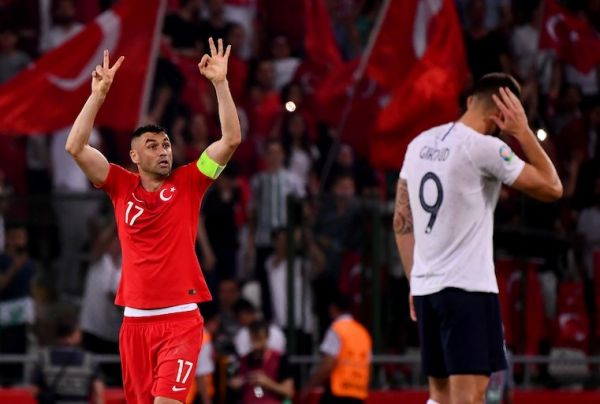 Turkey's forward Burak Yilmaz (L) celebrates after his teammate Turkey's Midfielder Cengiz Under scores his team's second goal during the Euro 2020 football qualification match between Turkey and France at the Buyuksehir Belediyesi stadium in Konya, on June 8, 2019. PHOTO/AFP