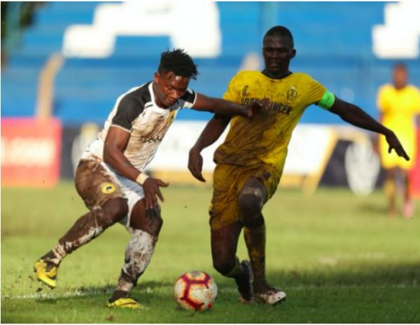Tusker FC's George 'Blackberry' Ogutu (left) shields the ball in a recent league match against Wazito FC. PHOTO | DUNCAN SIRMA | SPN