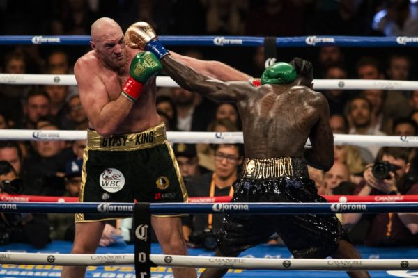 Tyson Fury (L) in action against Deontay Wilder (R) during WBC Heavyweight Championship at the Staples Center in Los Angeles, California on December 01, 2018. PHOTO | AFP