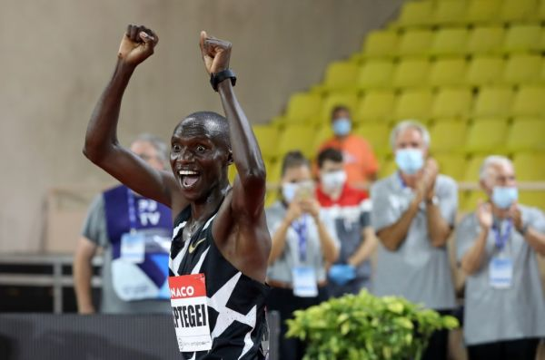Uganda's Joshua Cheptegei celebrates after winning and breaking the world record in the men's 5000metre event during the Diamond League Athletics Meeting at The Louis II Stadium in Monaco on August 14, 2020. PHOTO | AFP