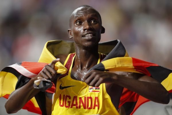 Uganda's Joshua Cheptegei holds the national flag after winning the Men's 10,000m final at the 2019 IAAF Athletics World Championships at the Khalifa International stadium in Doha on October 6, 2019. PHOTO | AFP