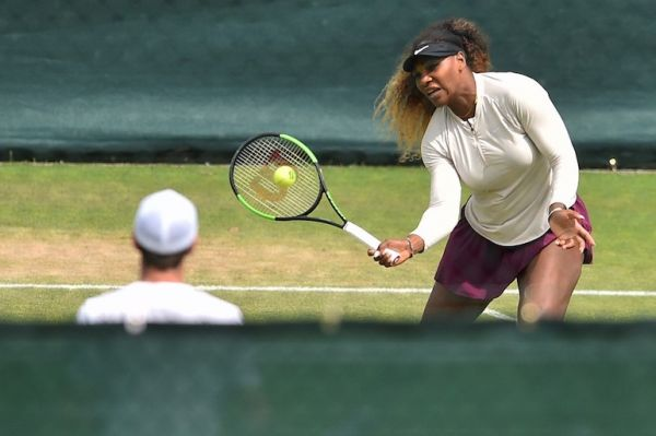 US player Serena Williams (R) and Britain's Andy Murray take part in a session on the practice courts on day nine of the 2019 Wimbledon Championships at The All England Lawn Tennis Club in Wimbledon, southwest London, on July 10, 2019.  Glyn KIRK / AFP