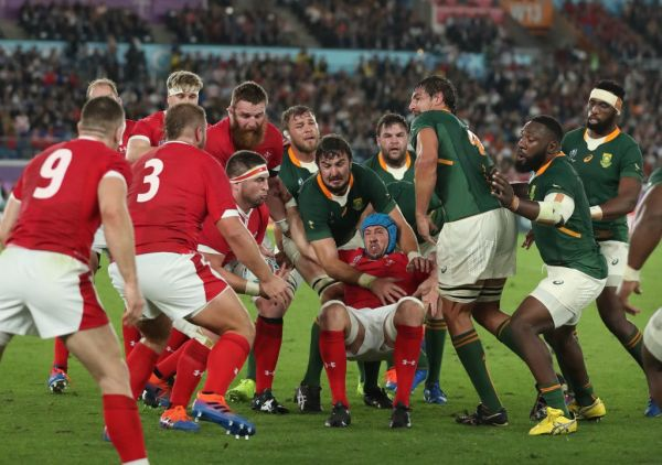 Wales' and South Africa's players struggle to hold a ball during the first half of the Semi-Finals in the 2019 Rugby World Cup Japan at International Stadium Yokohama in Yokohama, Kanagawa Prefecture on Oct. 27, 2019. PHOTO | AFP