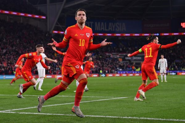 Wales' midfielder Aaron Ramsey celebrates scoring his team's second goal during the Group E Euro 2020 football qualification match between Wales and HUngary at Cardiff City Stadium in Cardiff, Wales on November 19, 2019. PHOTO | AFP