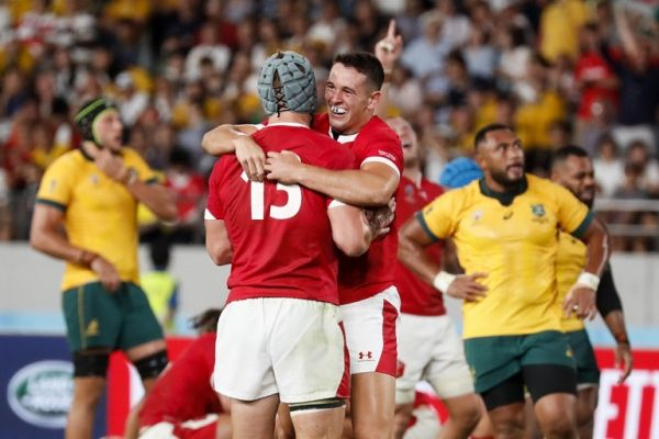 Wales' players celebrate after winning the Japan 2019 Rugby World Cup Pool D match between Australia and Wales at the Tokyo Stadium in Tokyo on September 29, 2019. PHOTO | AFP
