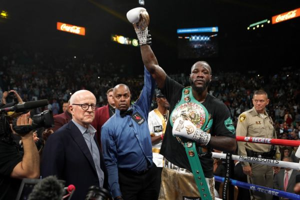WBC heavyweight champion Deontay Wilder poses with referee Kenny Bayless after defeating Luis Ortiz in their title fight at MGM Grand Garden Arena on November 23, 2019 in Las Vegas, Nevada. Wilder won with a seventh-round knockout.  PHOTO | AFP