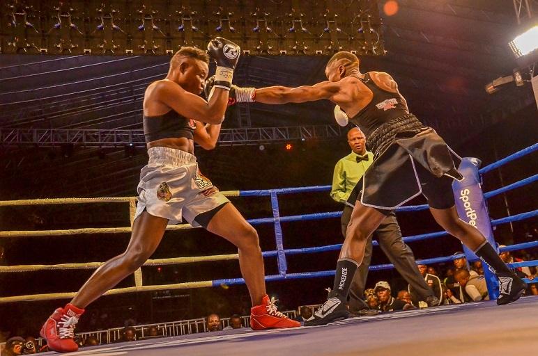 WBC Super Bantamweight Champion Fatuma Zarika punches Zambian Catherine Phiri during their title bout at the KICC on Saturday, March 23, 2019. PHOTO/SPN