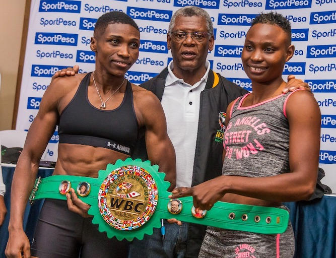 WBC women Super bantamweight champion, Fatuma 'Iron Fist' Zarika (left) and WBC Supervisor Dr. Peter Ngatane and challenger Catherine Phiri (right) pose during the weigh in of their title fight on March 22, 2019. PHOTO/Brian Kinyanjui